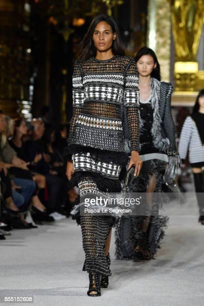 Cindy Bruna walks the runway during the Balmain show as part of the Paris Fashion Week Womenswear Spring/Summer 2018 on September 28 2017 in Paris...