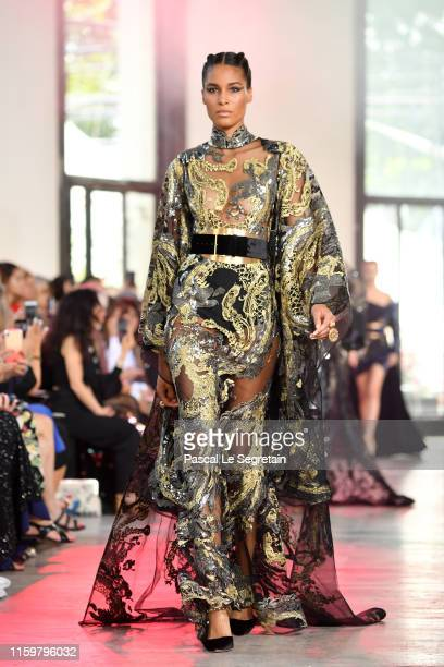 Cindy Bruna walks the runway during the Elie Saab Haute Couture Fall/Winter 2019 2020 show as part of Paris Fashion Week on July 03, 2019 in Paris,...