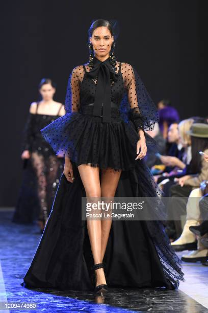 Cindy Bruna walks the runway during the Elie Saab show as part of the Paris Fashion Week Womenswear Fall/Winter 2020/2021 on February 29 2020 in...