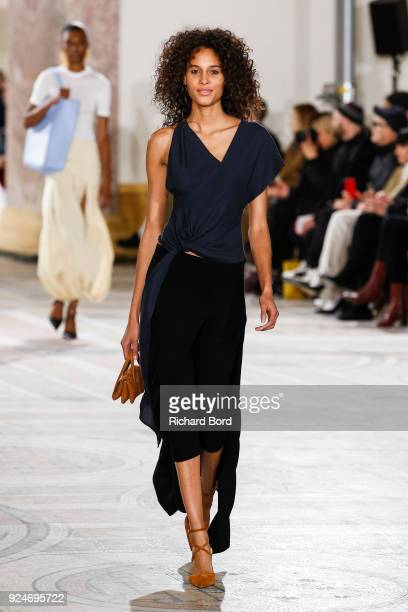 Cindy Bruna walks the runway during the Jacquemus show at Petit Palais as part of the Paris Fashion Week Womenswear Fall/Winter 2018/2019 on February...