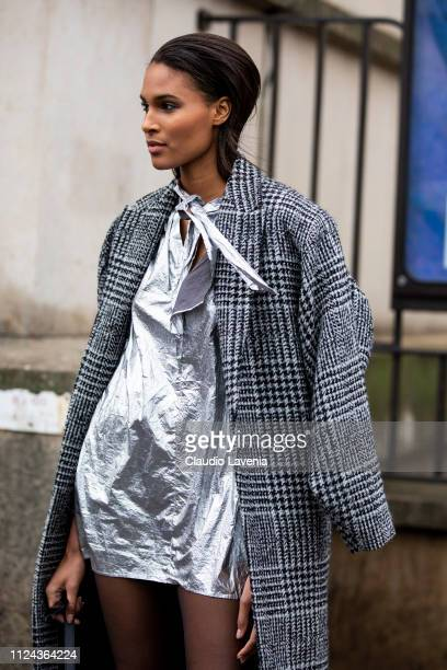 Cindy Bruna wearing a silver mini dress and grey checked coat is seen outside Elie Saab show during Paris Fashion Week Haute Couture Spring Summer...
