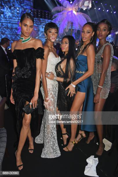Cindy Bruna Winnie Harlow Nicki Minaj Joan Smalls and guest attend the amfAR Gala Cannes 2017 at Hotel du CapEdenRoc on May 25 2017 in Cap d'Antibes...