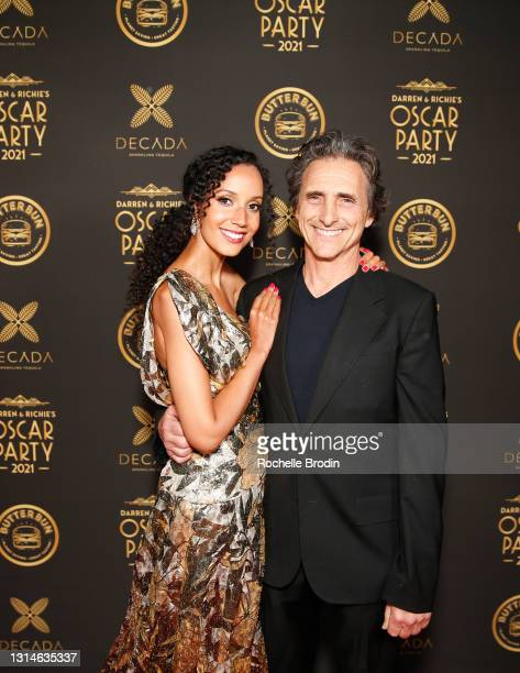 Cindy Cederlund and producer Lawrence Bender attend Darren Dzienciol & Richie Akiva's Oscar Party 2021 on April 25, 2021 in Bel Air, California.