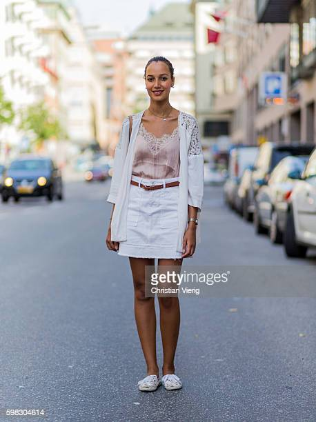 Cindy Cederlund wearing a laced cardigan and top white mini skirt and flats during the third day of the Stockholm Fashion Week Spring/Summer 2017 on...