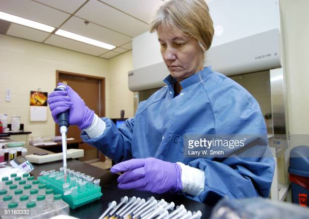 Cindy ChardBergstrom a Micro Biologist III at Kansas State University works on Aliquoting the Positive Control during a Check Test for Bovine...