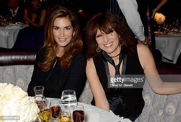 Cindy Crawford and Chrissie Hynde attend a private dinner celebrating the opening of the OMEGA Oxford Street boutique at Aqua Shard on December 10...