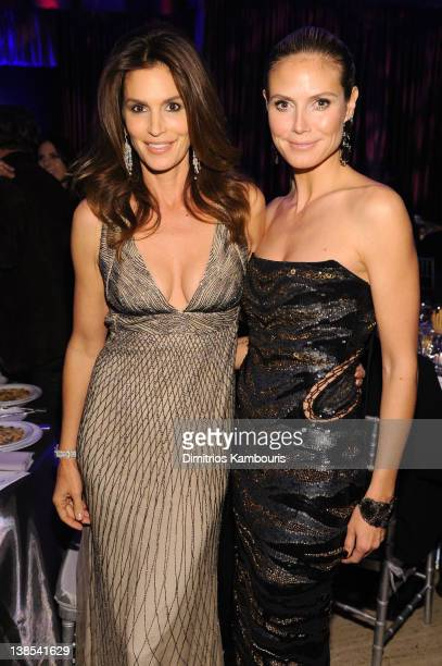 Cindy Crawford and Heidi Klum attend the amfAR New York Gala To Kick Off Fall 2012 Fashion Week Presented By Hublot at Cipriani Wall Street on...