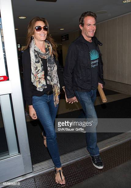 Cindy Crawford and her husband Rande Gerber are seen arriving at LAX airport on December 5 2013 in Los Angeles California