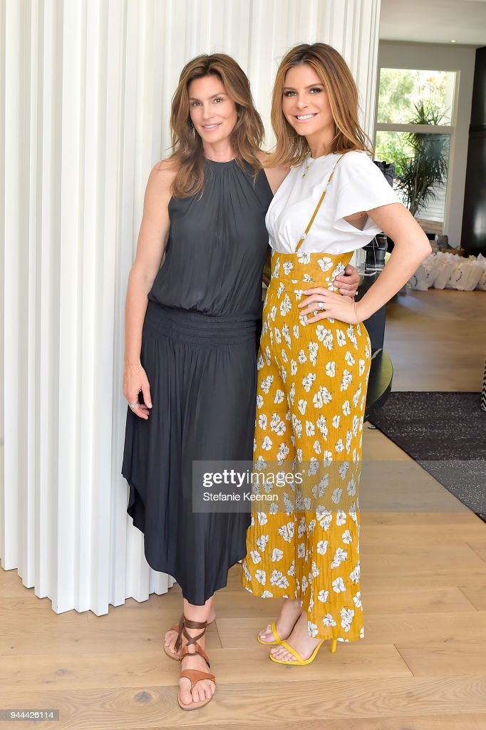 Cindy Crawford (L) and Maria Menounos attend Cindy Crawford x Sarah Flint celebrate the Sarah Flint spring footwear collection at a private residence on April 10, 2018 in Beverly Hills, California.