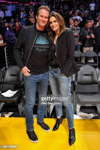 Cindy Crawford and Rande Gerber attend a basketball game between the Los Angeles Lakers and the Portland Trail Blazers at Staples Center on November...