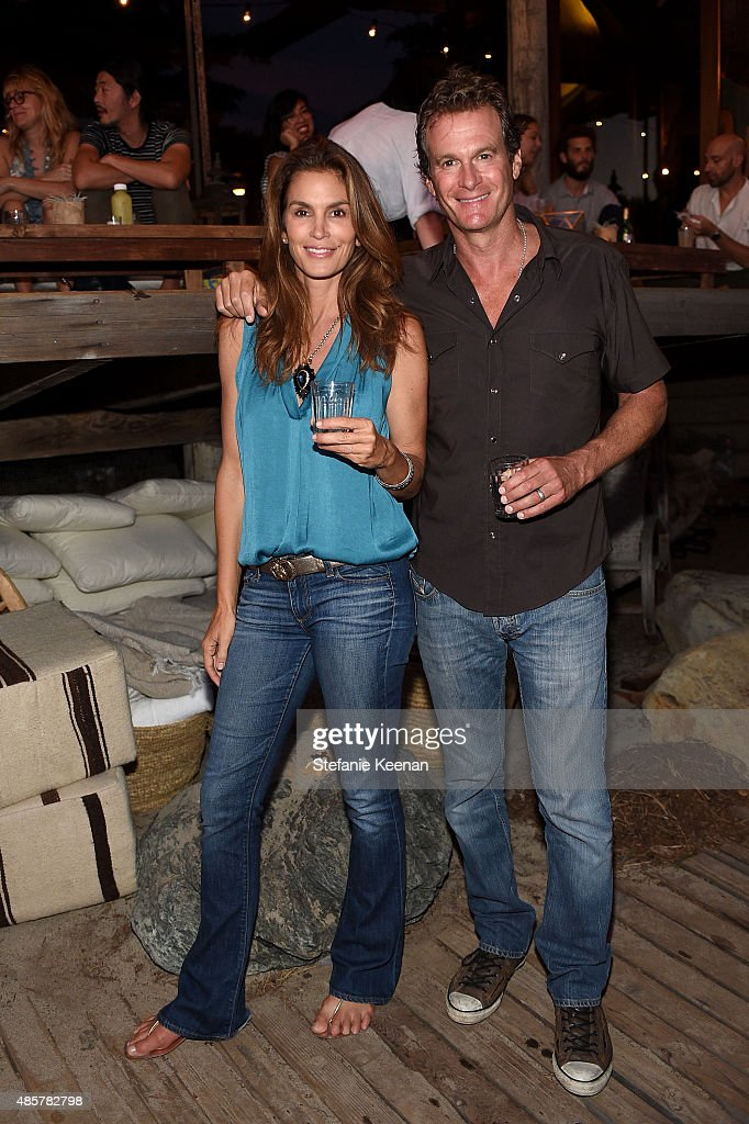 Cindy Crawford and Rande Gerber attend Kelly Slater, John Moore and Friends Celebrate the Launch of Outerknown at Private Residence on August 29, 2015 in Malibu, California.