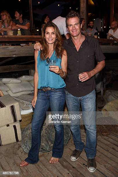 Cindy Crawford and Rande Gerber attend Kelly Slater John Moore and Friends Celebrate the Launch of Outerknown at Private Residence on August 29 2015...