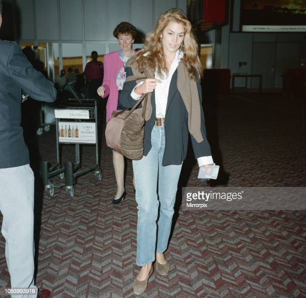 Cindy Crawford at London Heathrow Airport. Cindy is with her husband, actor, Richard Gere. He is out of shot, but in another frame in this set. The...