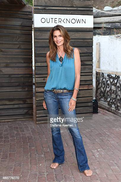 Cindy Crawford attends Kelly Slater John Moore and Friends Celebrate the Launch of Outerknown at Private Residence on August 29 2015 in Malibu...