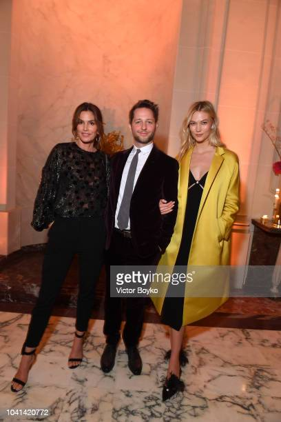 Cindy Crawford Derek Blasberg and Karlie Kloss attend the YouTube cocktail party during Paris Fashion Week on September 26 2018 in Paris France