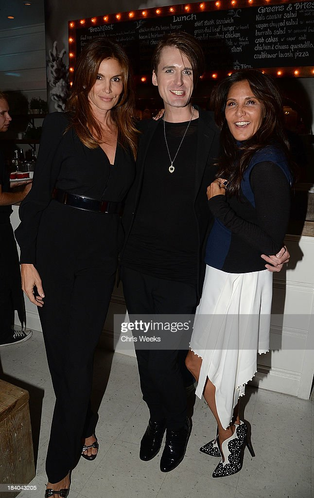 Cindy Crawford, fashion designer Gareth Pugh and Laurie Lynn Stark attend a dinner for Pugh hosted by Chrome Hearts at Malibu Farm on October 10, 2013 in Malibu, California.