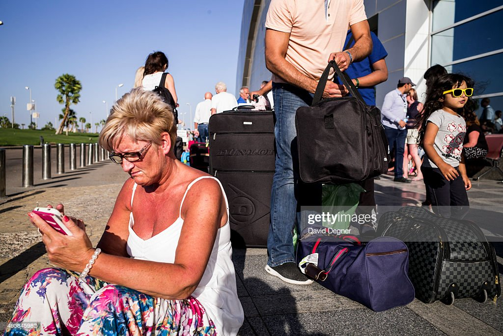Cindy Crawford from near Glasgow, Scotland sits on the sidewalk outside the terminal waiting for more information on a flight on November 05, 2015 in Sharm El-Sheikh, Egypt. If the tourism industry in Egypt collapses, workers who rely on the tourist industry could lose their income. British flights going to and from the Egyptian resort were grounded today, as investigations continue into the crash of a Russian Airbus-321 earlier this week. This will affect around 20,000 British tourists currently in Sharm El-Sheikh according to Downing Street.