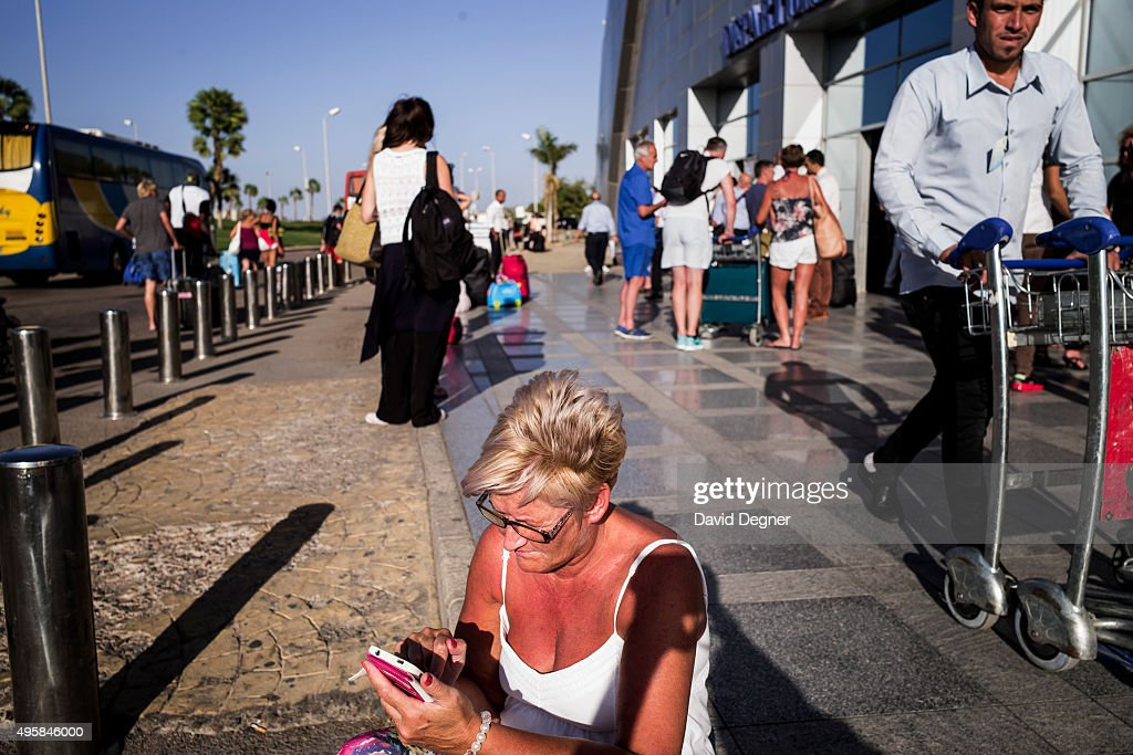 Cindy Crawford from near Glasgow, Scotland, sits on the sidewalk outside the terminal waiting for more information on a flight on November 05, 2015 in Sharm El-Sheikh, Egypt. If the tourism industry in Egypt collapses, workers who rely on the tourist industry could lose their income. British flights going to and from the Egyptian resort were grounded today, as investigations continue into the crash of a Russian Airbus-321 earlier this week. This will affect around 20,000 British tourists currently in Sharm El-Sheikh according to Downing Street.