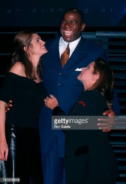 Cindy Crawford Magic Johnson and Carrie Fisher at the American ExpressMacy's Passport Barker Hanger Santa Monica Airport Santa Monica