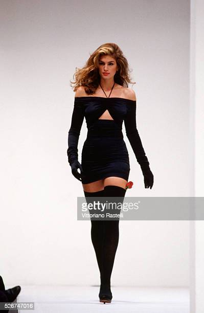 Cindy Crawford modeling on the catwalk at a presentation of Dolce e Gabbana's springsummer collection in Milan