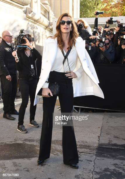 Cindy Crawford poses during the Chanel show as part of the Paris Fashion Week Womenswear Spring/Summer 2018 on October 3 2017 in Paris France