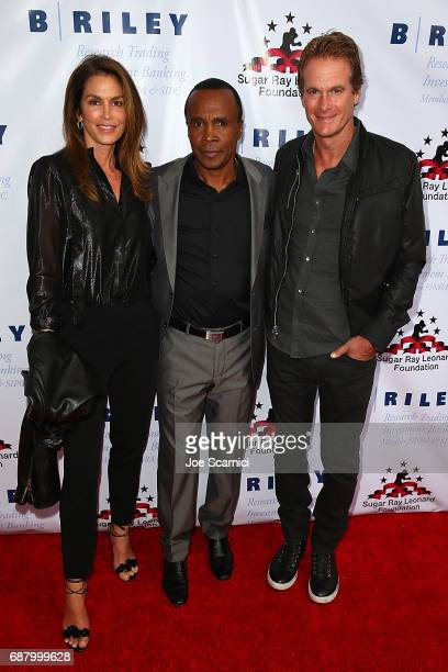 Cindy Crawford Sugar Ray Leonard and Rande Gerber attend the 8th Annual 'Big Fighters Big Cause' Charity Boxing Night at the Loews Santa Monica Beach...