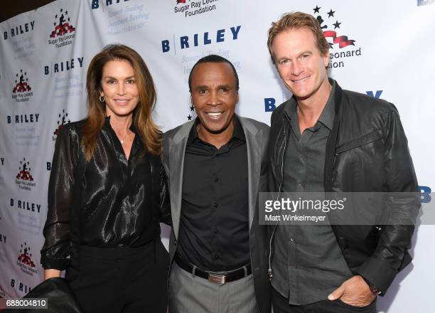 Cindy Crawford Sugar Ray Leonard and Rande Gerber attend the B Riley Co 8th Annual 'Big Fighters Big Cause' Charity Boxing Night benefiting the Sugar...
