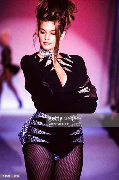 Cindy Crawford walks the runway at the Thierry Mugler Ready to Wear Fall/Winter 1990-1991 fashion show during the Paris Fashion Week in March, 1990...