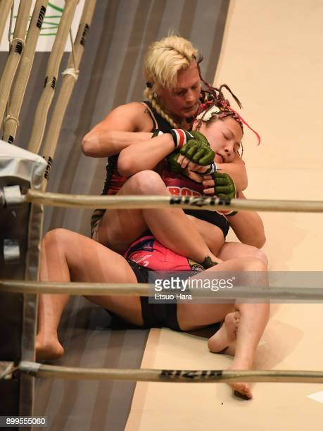 Cindy Dandois of Belgium attempts to secure a choke submission against KING Reina of Japan in the women's bout during the RIZIN Fighting World...