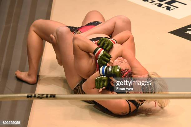 Cindy Dandois of Belgium attempts to secure a rear choke submission against KING Reina of Japan in the women's bout during the RIZIN Fighting World...