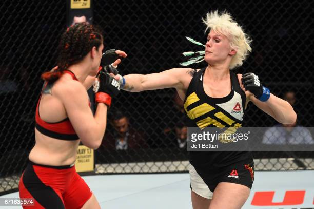 Cindy Dandois of Belgium punches Alexis Davis in their women's bantamweight bout during the UFC Fight Night event at Bridgestone Arena on April 22...