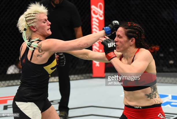 Cindy Dandois of Belgium punches Alexis Davis of the Canada in their women's bantamweight bout during the UFC Fight Night event at Bridgestone Arena...