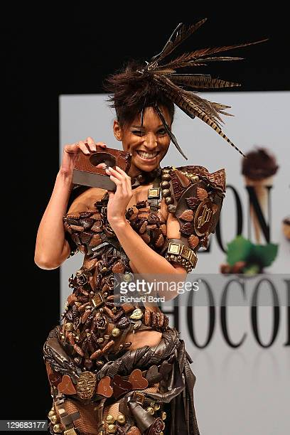 Cindy Fabre dressed by Benjamin Bout for Ben Brass and Tanguy Roelandts for Puyricard walks the runway during the chocolate dress fashion show...