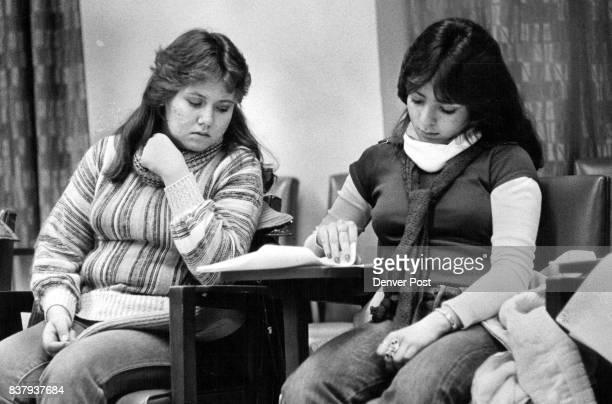 Cindy Hernandez left and Corrine Ortiz read over material on baby sitting for diabetic children Credit Denver Post