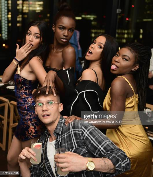 Cindy Kimberly Leomie Anderson Monica Geuze guest and Marcel attend the It Girls and MTV EMA Correspondents Dinner held at The Ace Hotel ahead of the...