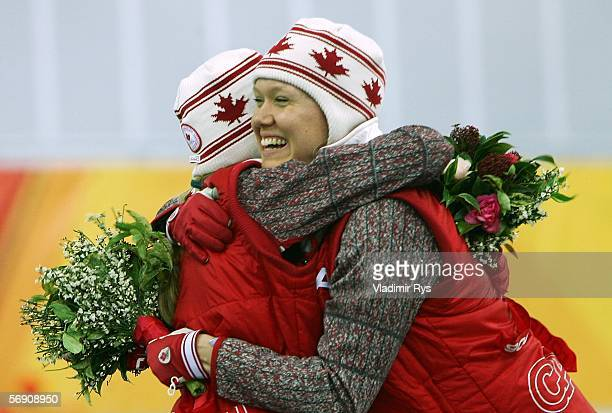 Cindy Klassen and Kristina Groves both of Canada hug after winning gold and silver respectively in the 1500m women's Speed Skating Final during Day...