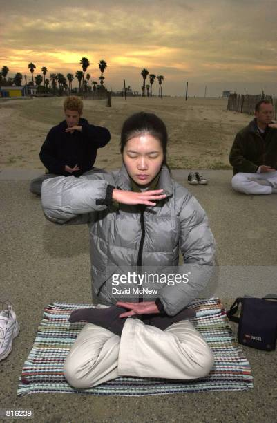 Cindy Lee practices early morning Falun Dafa exercises at Santa Monica State Beach March 3 2001 in Santa Monica CA Also known as Falun Gong Falun...