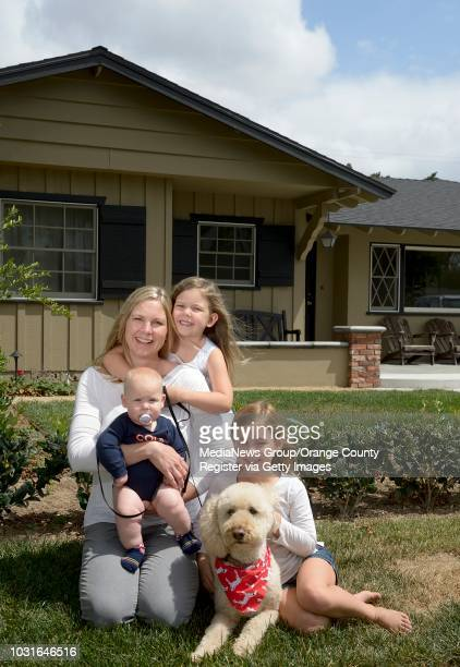 Cindy Maddox with three of her five children Noah Maddox 6 months Olivia Maddox center and Ellie Maddox right outside their home in Orange on...