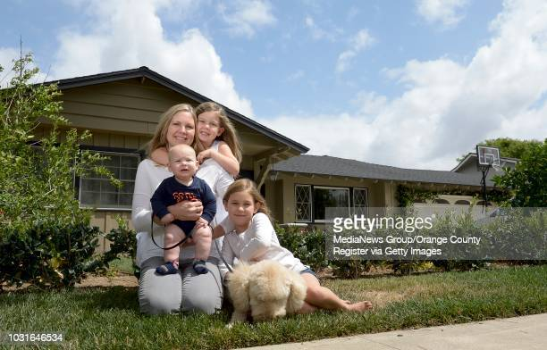 Cindy Maddox with three of her five children, Noah Maddox, 6 months, Olivia Maddox center, and Ellie Maddox right, outside their home in Orange on...