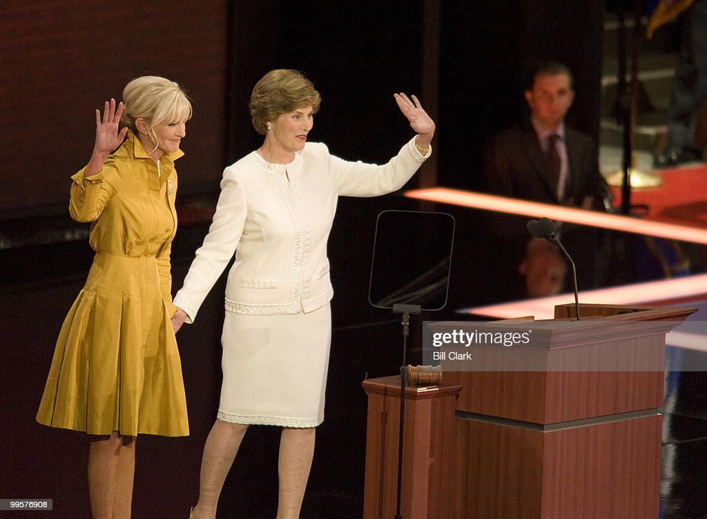 Cindy McCain and First Lady Laura Bush wave to the crowd after speaking during the Republican National Convention at the Excel Center in St. Paul, Minn., on Monday, Sept. 1, 2008.