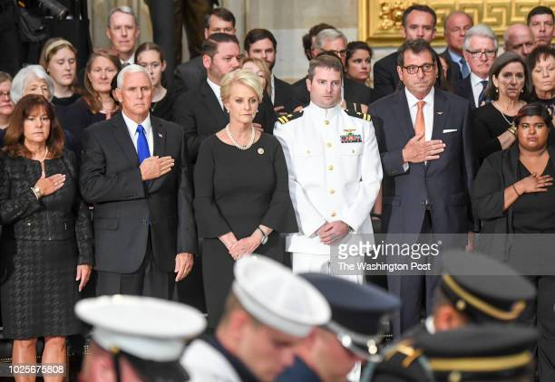 Cindy MCCain and her son Jack stand along with Vice President Mike Pence and his wife Karen as the body of lateSen John S McCain arrives to lie in...
