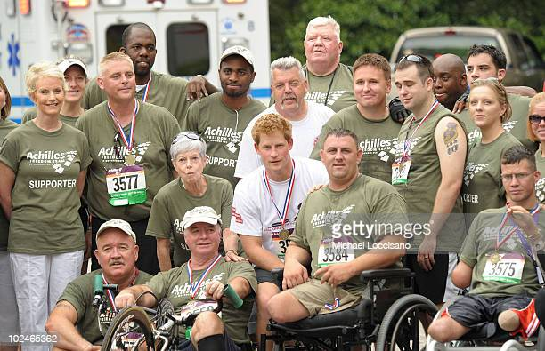 Cindy McCain and Prince Harry pose with Team Achilles following the Achilles Hope and Possibility Race in Central Park on June 27 2010 in New York...