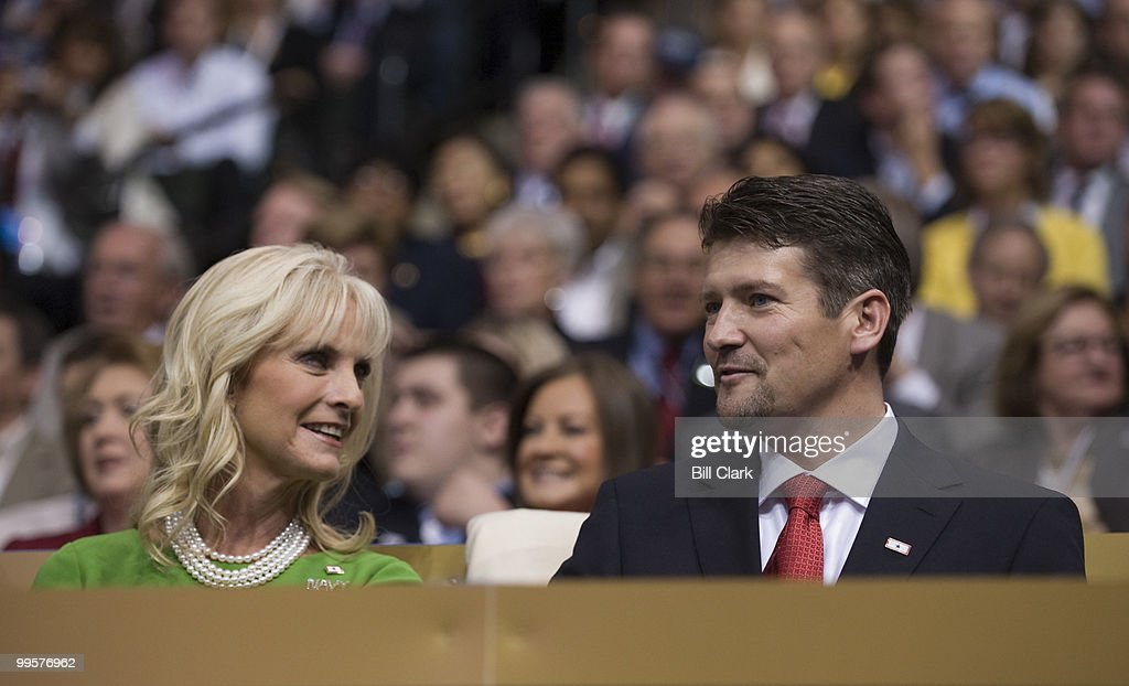 Cindy McCain and Todd Palin talk in the VIP box on the floor of the Republican National Convention at the Xcel Center in St. Paul, Minn., on Wednesday, Sept. 3, 2008.