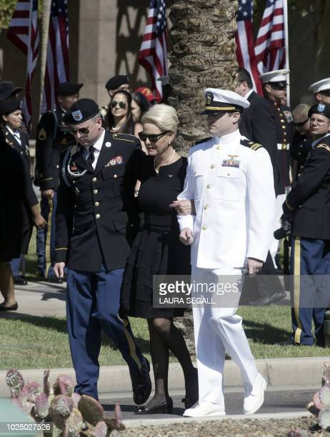 Cindy McCain escorted by her son's Jack and Jimmy McCain arrive at the Arizona State Capitol for the service for her husband Senator John McCain...