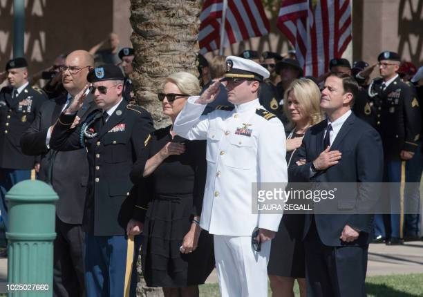 Cindy McCain escorted by her son's Jack and Jimmy McCain arrives at the Arizona State Capitolwith Arizona Governor Doug Ducey for the service for her...