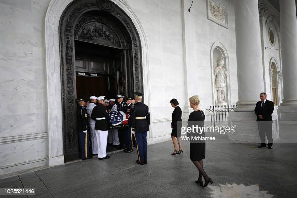Cindy McCain follows a military honor guard team as they carry the casket of her husband the lateSen John McCain into the US Capitol August 31 2018...