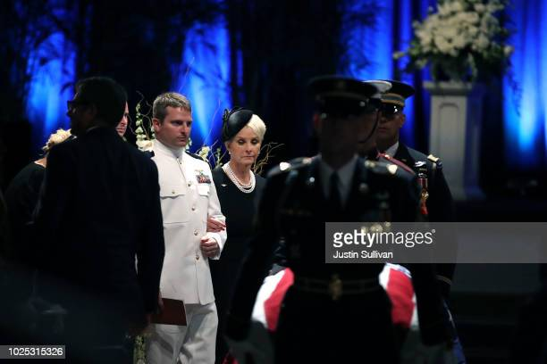 Cindy McCain follows military pallbearers as they escort the casket of US Sen John McCain at the conclusion to memorial service at the North Phoenix...