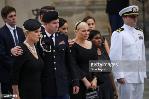 Cindy McCain her son James McCain daughter Meghan McCain Bridget McCain and John Sidney McCain IV look on as the casket of the late Senator John...
