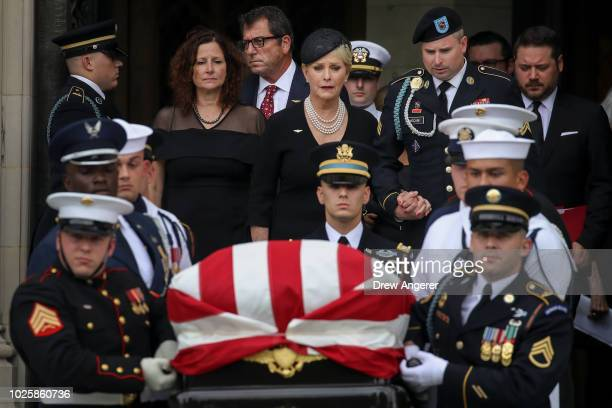 Cindy McCain holds hands with her son James McCain as they follow a joint military service casket team carrying the casket of the late Senator John...
