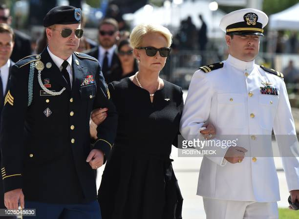Cindy McCain is escorted by her sons Jimmy McCain and Jack McCain as they follow the casket of her husband and their father Senator John McCain into...